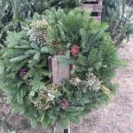Christmas wreath on fence post
