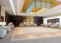 Large, carpeted hotel lobby