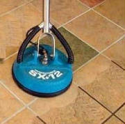 Machine cleaning grout on tile