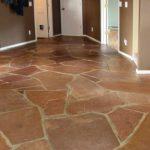 Red, stone tile floor freshly cleaned