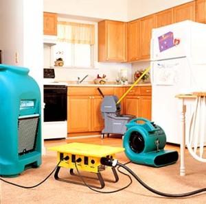 Water Restoration tools on floor of kitchen